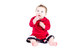 Little baby girl in a red dress Royalty Free Stock Photography