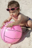 Little baby girl on the sand beach Stock Images