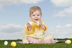 Little baby girl with easter eggs Royalty Free Stock Images