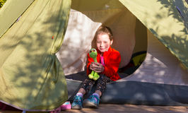 Little Baby Girl sitting in Camping Tent in Forest Stock Photos