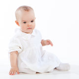 Little baby girl sitting on the floor Stock Images