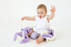 Little baby girl sitting on floor with plaid isolated Royalty Free Stock Photos