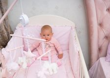 Little Baby Girl Sitting In Her Crib. Stock Photos