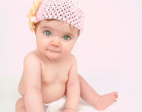 Little Baby Girl Sitting on Pink stock images