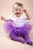 Little baby girl sitting in tutu skirt Stock Image