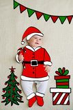 Little baby girl sketched like Santa stock image