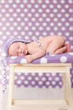 Little baby girl, sleeping on a chair. With hat Royalty Free Stock Photography