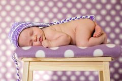Little baby girl, sleeping on a chair. With hat Royalty Free Stock Photos