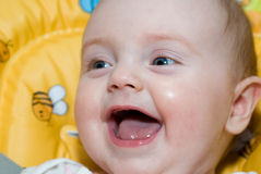 Little baby girl smiling very happily Stock Image