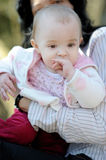 Little baby girl in spring forest Stock Images