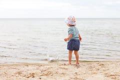 Baby girl beach. Little baby girl standing at the beach stock image