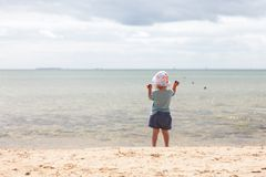 Baby girl beach. Little baby girl standing at the beach stock images