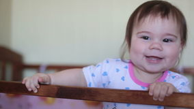 Little baby girl standing on the bed and laughing stock video