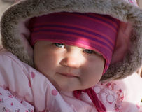 Little baby girl by sun beam illuminates Royalty Free Stock Photo