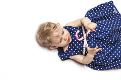 Little baby girl with sweets Stock Images