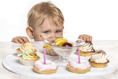 Little baby girl with sweets Stock Photos
