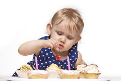Little baby girl with sweets Stock Photography