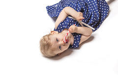 Little baby girl with sweets Royalty Free Stock Photography