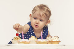 Little baby girl with sweets Royalty Free Stock Photo