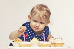 Little baby girl with sweets Royalty Free Stock Image