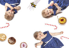 Little baby girl with sweets Stock Photo