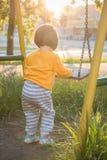 Little baby girl with swing Stock Photo