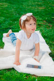 Little baby girl with Tablet Stock Photos
