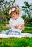 Little baby girl with Tablet Royalty Free Stock Photography