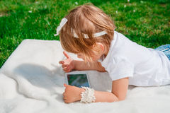 Little baby girl with Tablet Stock Image