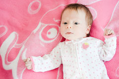 Little Baby Girl on pink background Stock Image
