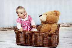 Little baby girl with teddy bear Royalty Free Stock Photography
