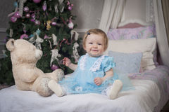 Little baby girl with teddy bear. And smile Stock Image
