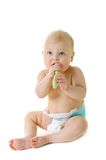 Little baby girl with teething brush Royalty Free Stock Images
