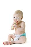 Little baby girl with teething brush Stock Image