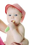 Little baby girl with teething brush Royalty Free Stock Image