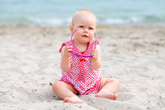 Little baby girl on tropical sand beach Royalty Free Stock Images