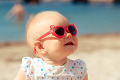 Little baby girl on tropical sand beach Stock Images