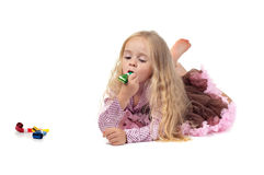 Little baby girl in tutu skirt using party blower Royalty Free Stock Photos