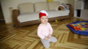 Little baby girl very funny dancing and moving in rhythm of music wearing very funny hat stock footage