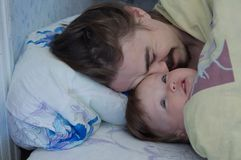 Little baby girl wake up in the morning. Parent tired sleeping stock images