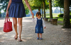 Little baby girl walking with beautiful mother in summer park Royalty Free Stock Photography