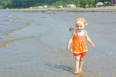 Little baby girl walking on the water Royalty Free Stock Photography