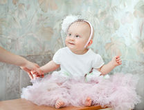 Little baby girl wearing beautiful dress Stock Photo