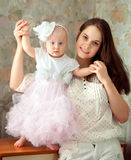 Little baby girl wearing beautiful dress Stock Images