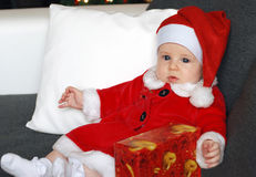 Little baby girl wearing a cute Santa Claus costume Royalty Free Stock Photography