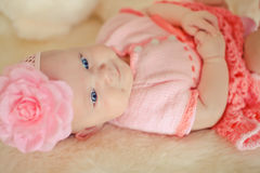 Little baby girl wearing pink knitting dres Stock Images