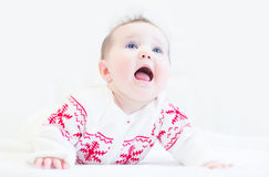 Little baby girl wearing a winter knitted sweater Stock Images