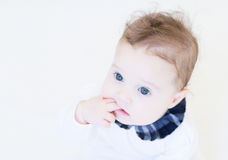 Little baby girl in a white shirt with plaid blue collar Royalty Free Stock Photography