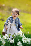 Little baby girl on wooden rocking horse Royalty Free Stock Photography