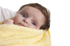 Little baby girl wrapped in a yellow towel Stock Photos